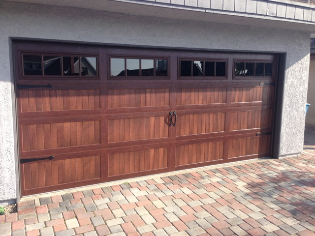 huge wooden garage door installed by Innovative Garage in Chicagoland