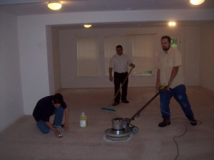 men cleaning the home's interior