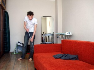 a guy cleaning his house