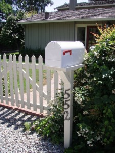 white fence and mailbox