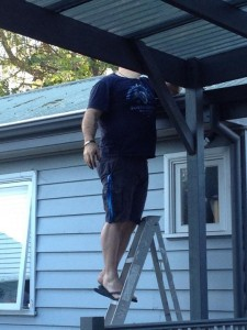 A man clean the roof.