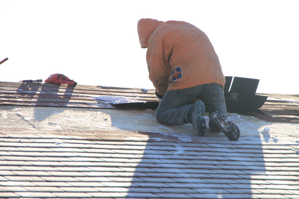 Roof shingle repair during winter.