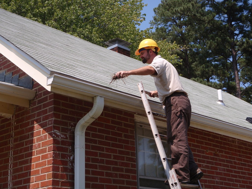 Mr. Cyrus Brame cleaning gutters