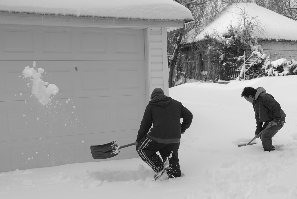Removing snow outside the house.