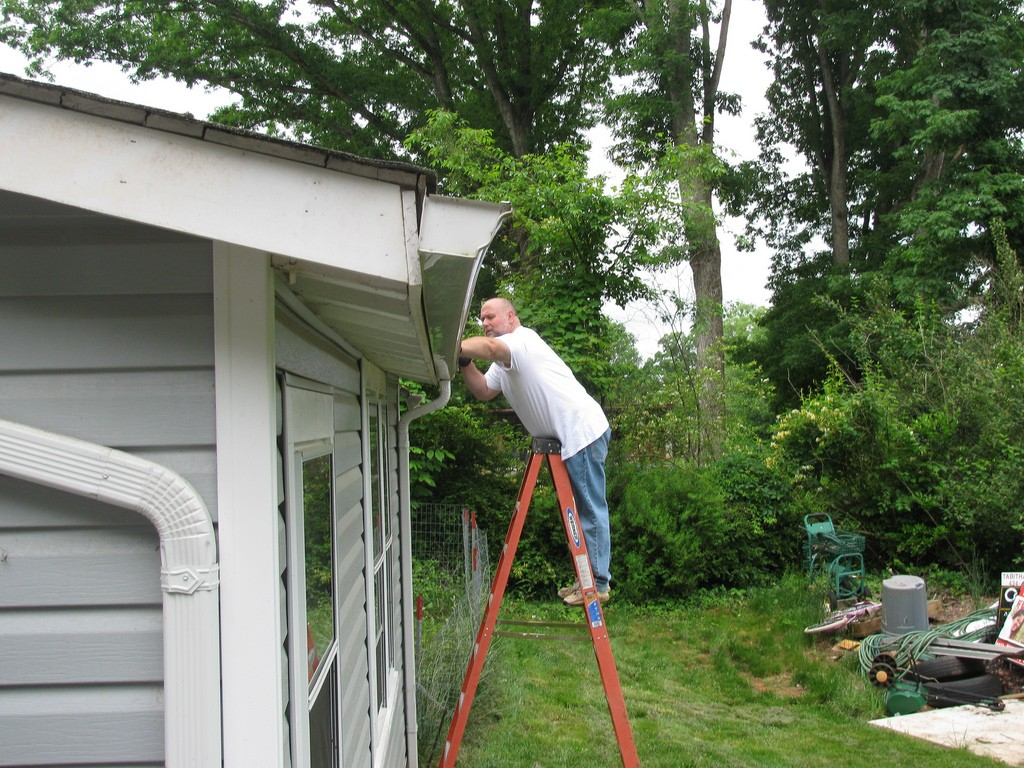 Cleaning gutters.